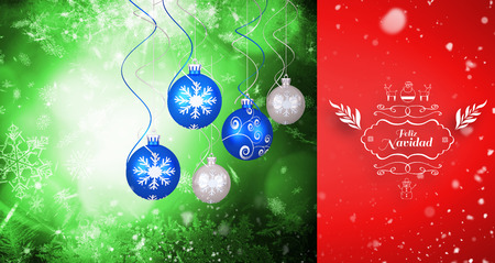 neige qui tombe: Snow falling against hanging christmas decorations