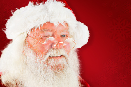 lean back: Santa claus winking against red background