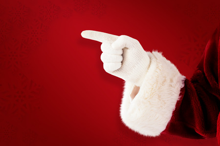 lean back: Santa Claus points at something against red background