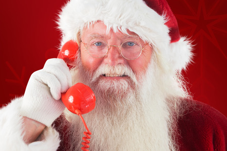 christmas golf: Santa on his red phone against red background