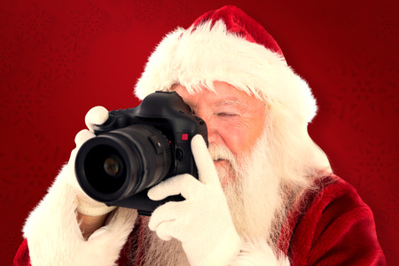 lean back: Santa is taking a picture against red background