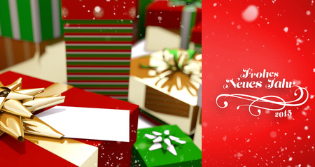wrapped up: Snow falling against colourful wrapped up christmas gifts Stock Photo
