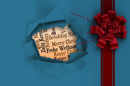 Navidad arco rojo y cinta contra el agujero círculo en papel