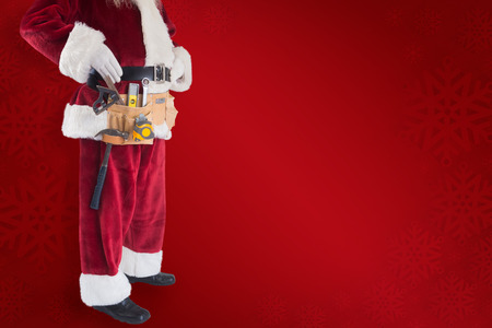 pushes: Santa pushes a shopping cart against red background