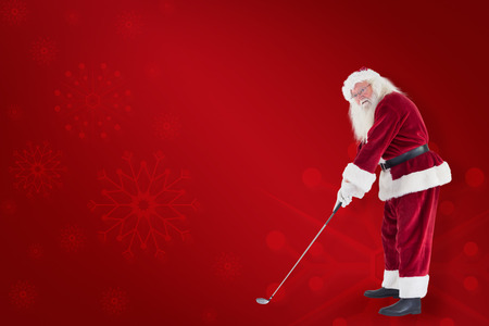 christmas golf: Santa pushes a shopping cart against red background