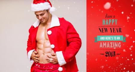 macho: Portrait of macho man in santa costume against red vignette
