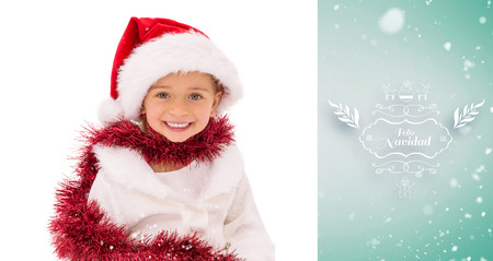 wearing santa hat: Cute little girl wearing santa hat and tinsel against green vignette