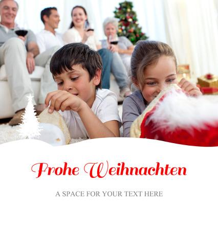 botas de navidad: Los niños buscan regalos en las botas de Navidad contra felicitación de la Navidad en alemán Foto de archivo