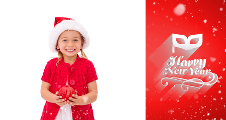 wearing santa hat: Cute little girl wearing santa hat holding bauble against red vignette Stock Photo