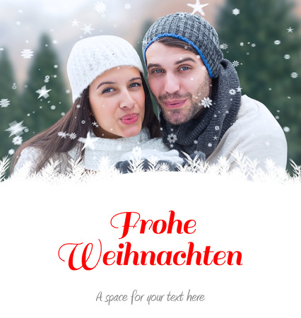 frohe: young winter couple against christmas greeting in german
