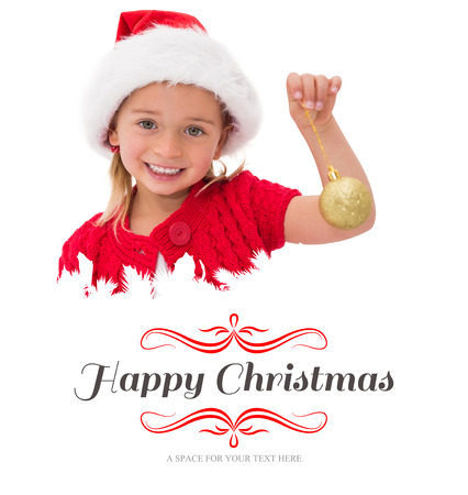 wearing santa hat: Cute little girl wearing santa hat holding bauble against border