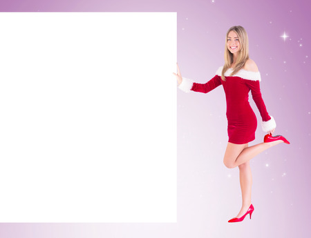 aon: Pretty santa girl smiling at camera aon vignette background Stock Photo
