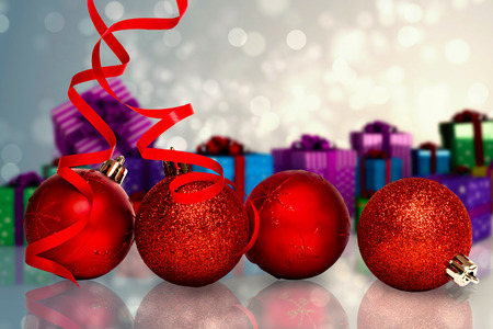 four red christmas ball decorations against light design shimmering on silver stock photo 42972156 - Christmas Ball Decorations