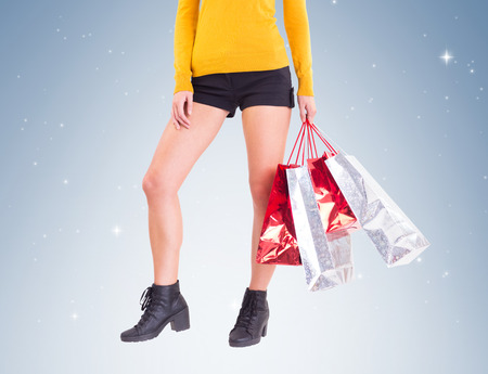 hot pants: Stylish woman with shopping bags on vignette background
