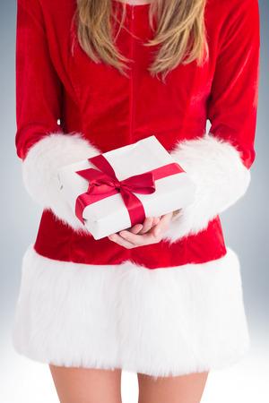 sexy santa girl: Sexy santa girl holding gift on vignette background