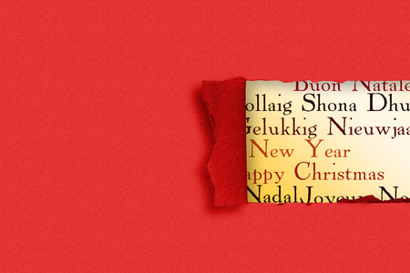 Rip in paper against holiday greetings in different languages stock rip in paper against holiday greetings in different languages stock photo 42966710 m4hsunfo