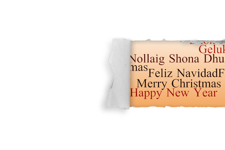 irish christmas: Rip in paper against holiday greetings in different languages