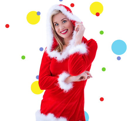 pere noel sexy: Festive blonds souriant à la caméra contre motif de points