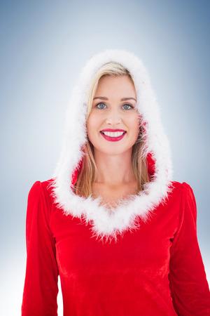 pere noel sexy: Festive blonds souriant à la caméra sur la vignette fond