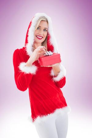 pere noel sexy: Blonds Festive tenant un cadeau sur la vignette fond