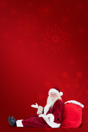 clue: Santa sits leaned on his bag and has no clue against red background