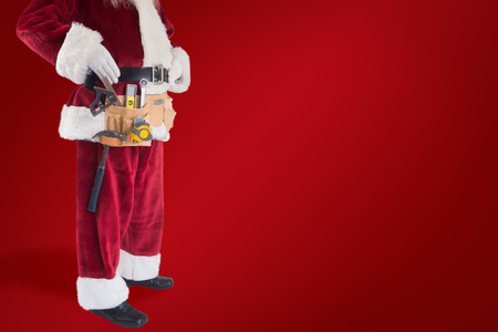 tool belt: Father Christmas is wearing a tool belt against red background