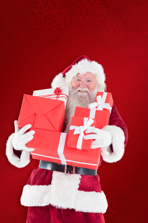 Santa carries a few presents against red background