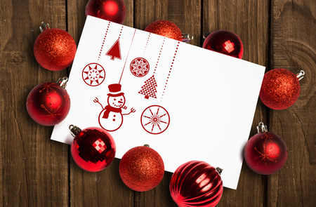 christmas cards: Hanging red christmas decorations against overhead of wooden planks