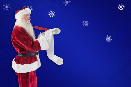 pere noel: Father Christmas writes a list against blue snowflake background