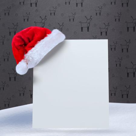grey pattern: Santa hat on poster against grey reindeer pattern