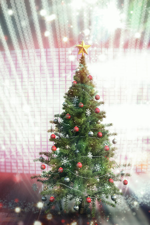 composite image: Composite image of christmas tree with falling snow