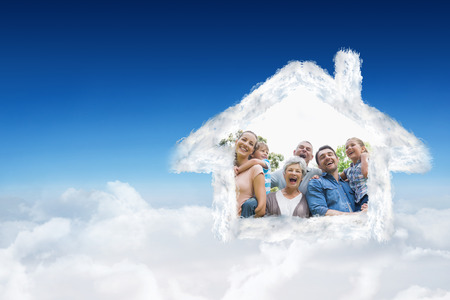 extended family: Portrait of cheerful extended family at park against blue sky over clouds Stock Photo
