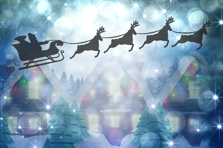 quaint: Silhouette of santa claus and reindeer against quaint town with bright moon Stock Photo