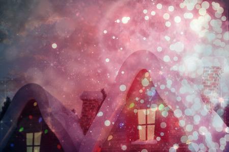 christmas village: Cute christmas village against light design shimmering on red Stock Photo