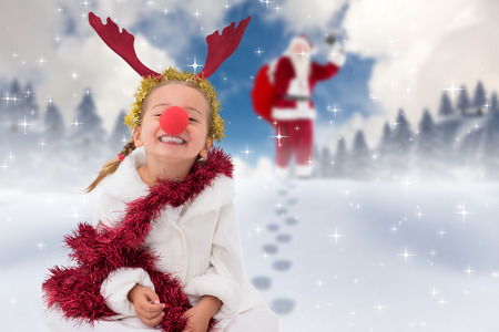red nose: Cute little girl wearing red nose and tinsel against blue sky with white clouds Stock Photo