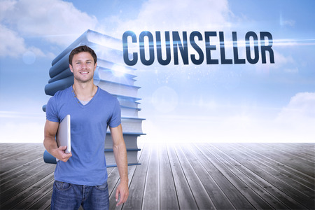 counsellor: The word counsellor and smiling man with closed laptop against stack of books against sky