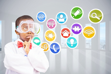 dressed up: Cute pupil dressed up as scientist against computing application icons Stock Photo