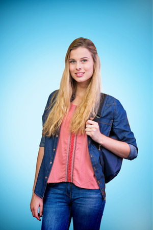 light hair: Pretty student in the library against blue background with vignette