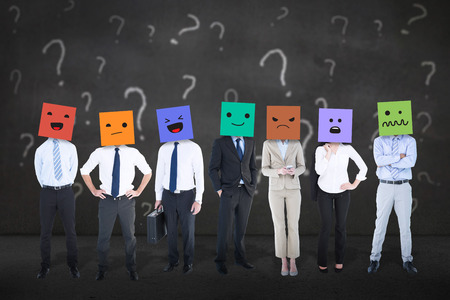 well dressed woman: People with boxes on their heads against white question marks on grey wall Stock Photo