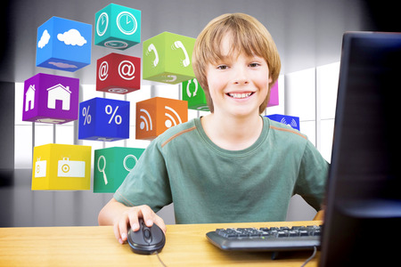 against abstract: School kid on computer against abstract room Stock Photo