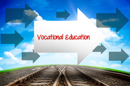 leading education: The word vocational education and arrow against railway leading to blue sky Stock Photo