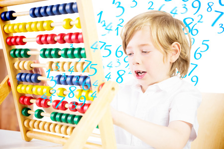 numeracy: Cute pupil using abacus against numbers