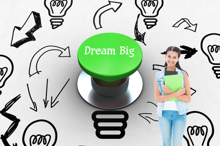 push button: The word dream big and student holding notepads against digitally generated green push button