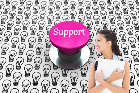 push button: The word support and student holding laptop against pink push button