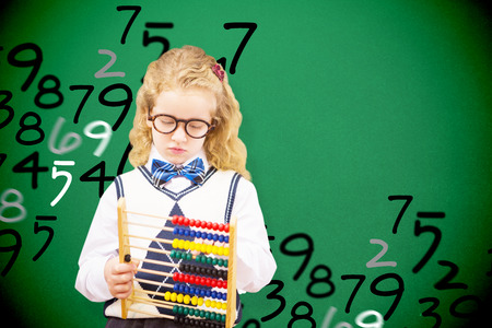 numeracy: Pupil holding abacus at elementary school  against green Stock Photo
