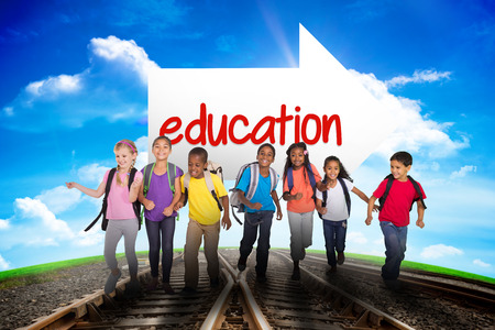 leading education: The word education and elementary pupils running against railway leading to blue sky Stock Photo