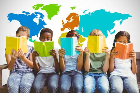 Children reading books at park against white background with vignette