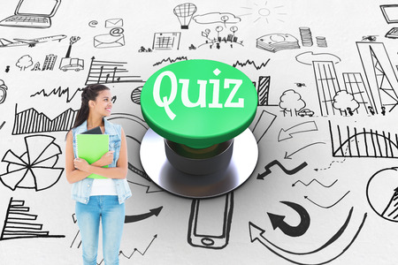 push button: The word quiz and student holding notepads against digitally generated green push button