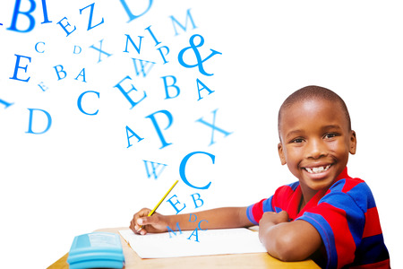 Happy pupil at desk against letters