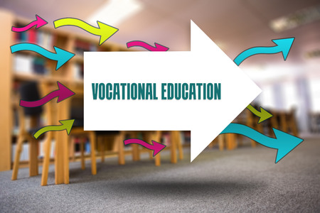 vocational: The word vocational education and arrows against volumes of books on bookshelf in library